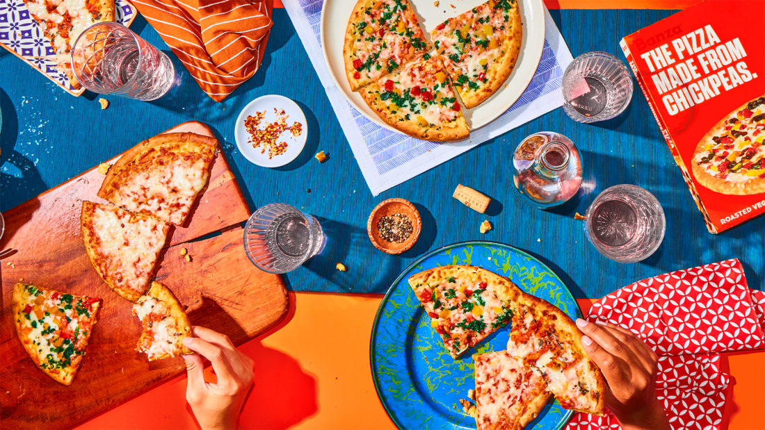 An aerial view of a picnic featuring Banza chickpea pizza crust.