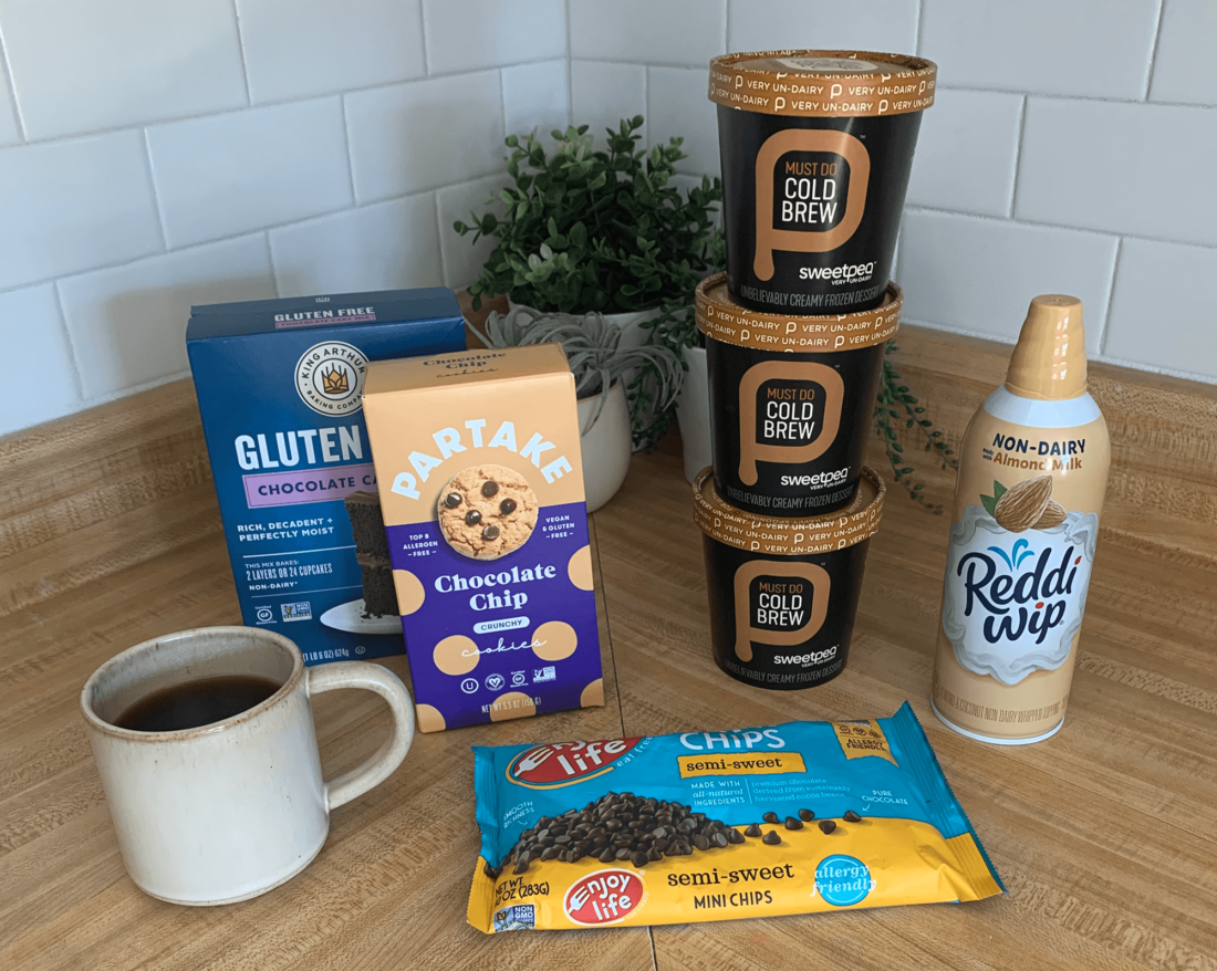 Ingredients for making plant-based ice cream cake arranged on a wooden counter.